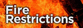 The words fire restrictions on a flaming background