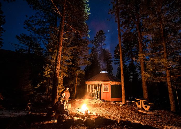 yurts in santa fe at night with campfire and stars