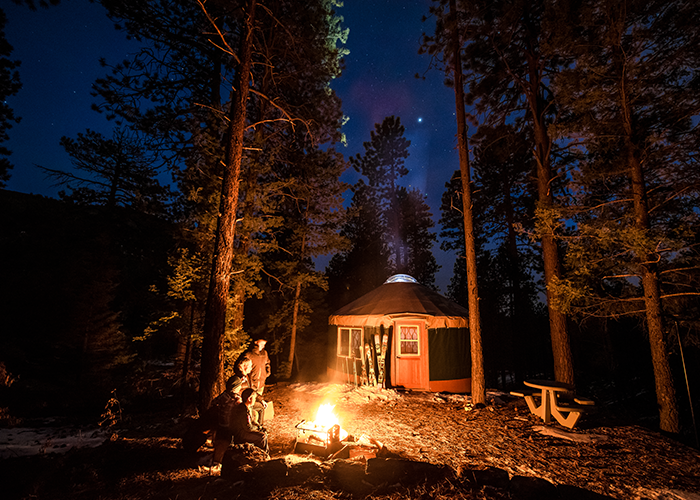 People camping by yurt