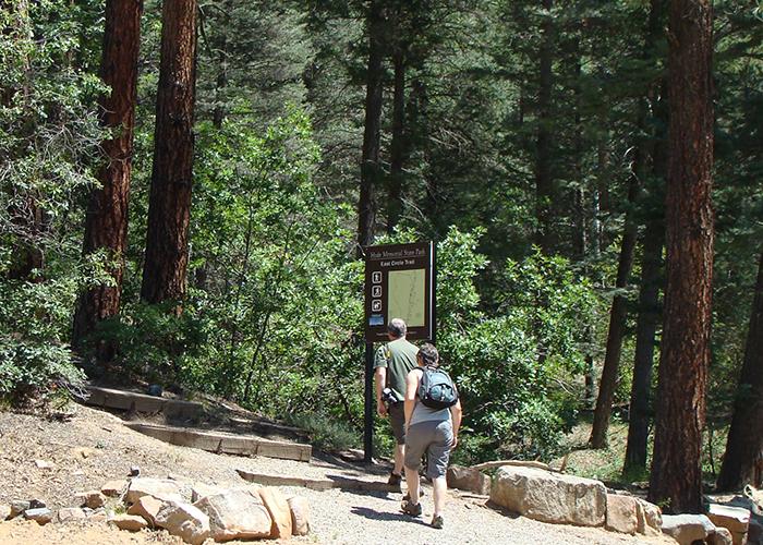 Two people walking trail