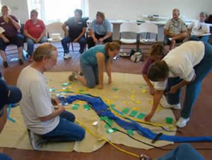 A group of people doing a floor activity