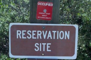 Sign says Reservation Site with red Occupied tag