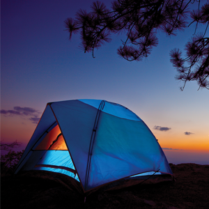 A blue camping tent at dusk