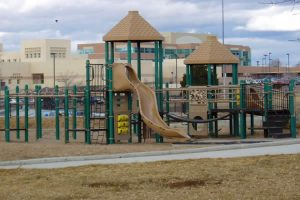 A tan and green play structure