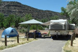 Campsite with some pavement, RVs and covered areas